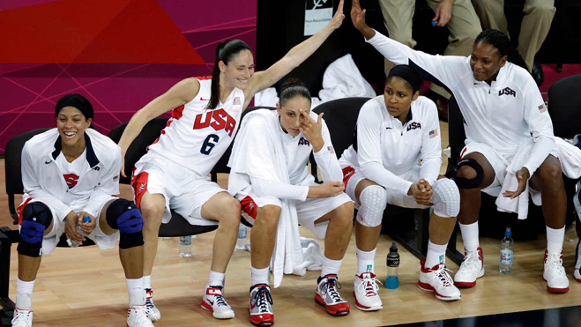Aug. 11: United States' players react on the bench during a women's gold medal basketball game against France at the 2012 Summer Olympics.