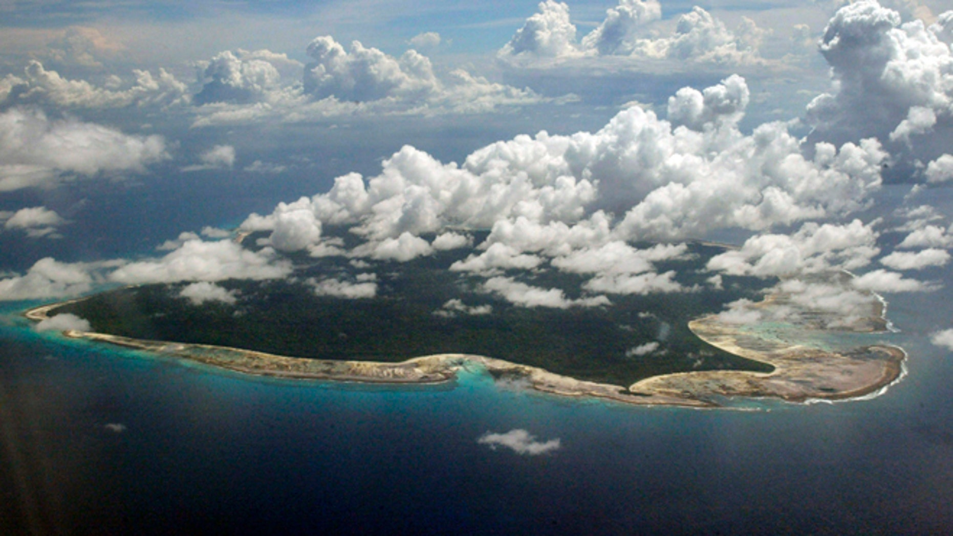 Clouds hang over the North Sentinel Island, in India's southeastern Andaman and Nicobar Islands. India used heat sensors on flights over hundreds of uninhabited Andaman Sea islands Friday, March 14, 2014, and will expand its search for the missing Malaysia Airlines jet farther west into the Bay of Bengal, officials said. The Indian-controlled archipelago that stretches south of Myanmar contains 572 islands covering an area of 720-by-52 kilometers. Only 37 are inhabited, with the rest covered in dense forests.