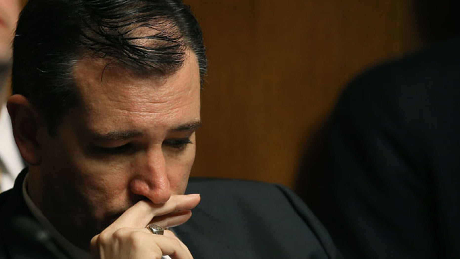"""WASHINGTON, DC - JUNE 04: Sen. Ted Cruz (R-TX) participates in a Judiciary Subcommittee hearing on the Affordable Care Act on Capitol Hill June 4, 2015 in Washington, DC. The hearing is billed as """"Rewriting The Law, Examining the Process That Led to the ObamaCare Subsidy Rule"""".  (Photo by Mark Wilson/Getty Images)"""
