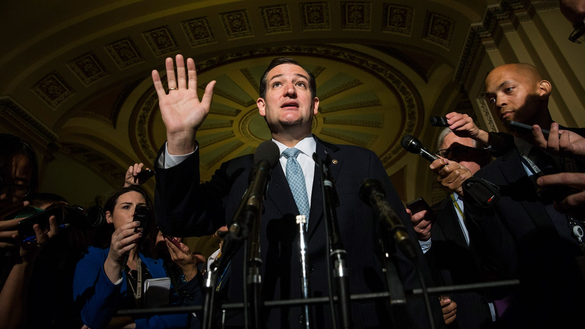 WASHINGTON, DC - OCTOBER 16:  U.S. Sen. Ted Cruz (R-TX) speaks after meeting with Republican senators regarding a bipartisan solution for the pending budget and debt limit impasse at the U.S. Capitol October 16, 2013 in Washington, DC. The Senate announced that it had reached a bipartisan deal on funding the federal government and the extending the nation's debt limit after 16 days of a government shutdown.  (Photo by Andrew Burton/Getty Images)