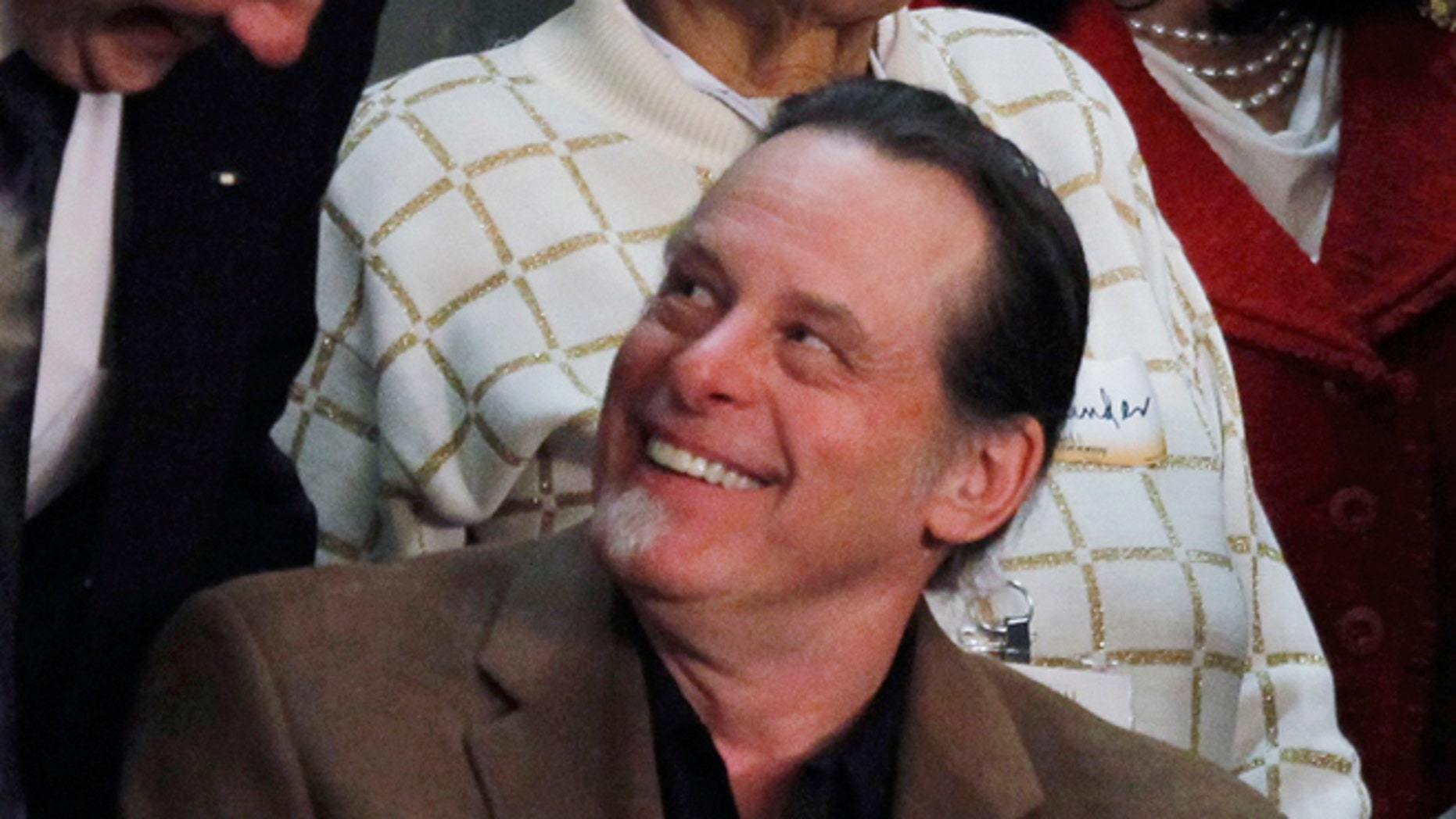 This Feb. 12, 2013 file photo shows musician Ted Nugent, guest of Rep. Steve Stockman, R-Texas, before the State of the Union address by President Barack Obama on Capitol Hill in Washington.
