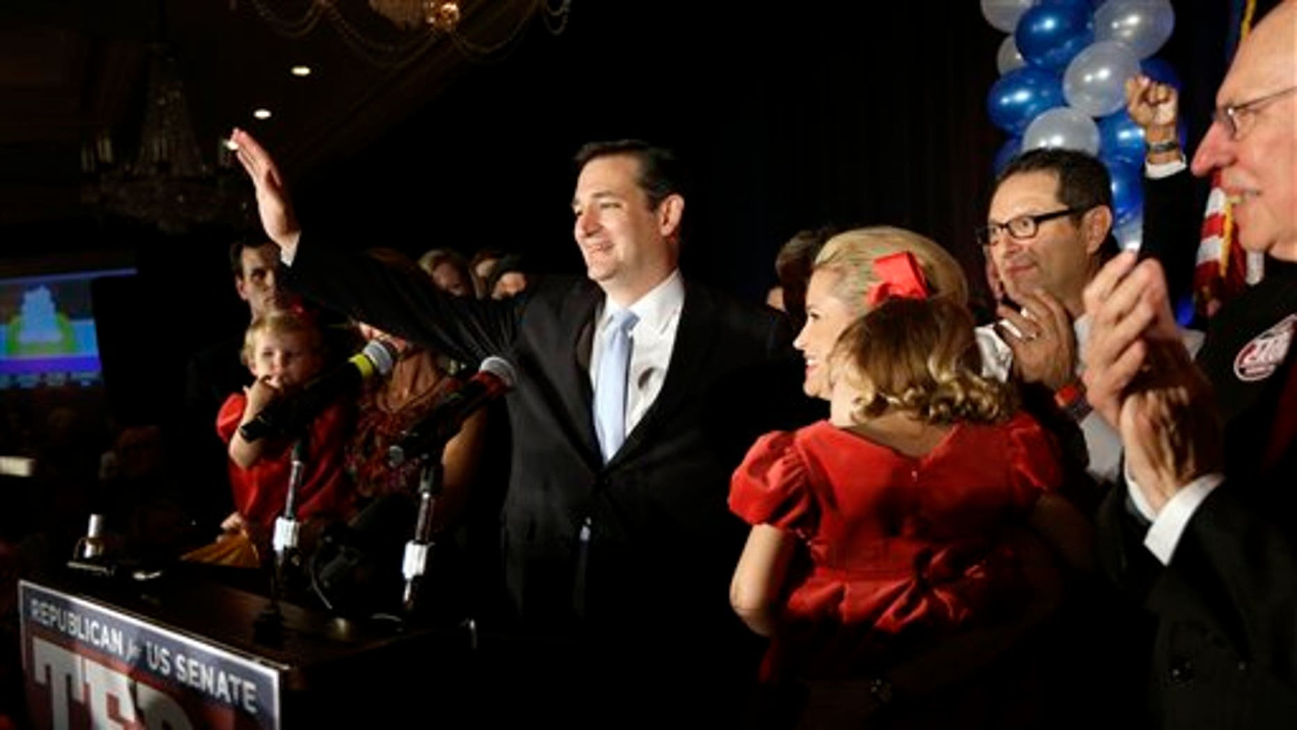Nov. 6, 2012: Republican candidate for U.S. Senate Ted Cruz thanks the crowd during a victory speech as he is joined on stage by his wife Heidi, right, in Houston.