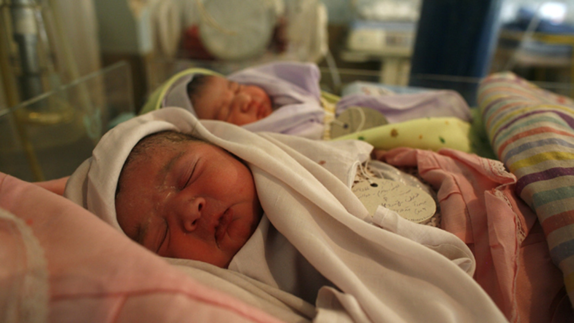 KABUL, AFGHANISTAN - OCTOBER 14:  Newborn babies rest inside the Neonatal ward at the Malalai Maternity hospital on October 14, 2007 in Kabul, Afghanistan. According to a UNICEF survey, one in nine Afghan women die during or shortly after pregnancy in Afghanistan, one of the highest rates in the world. At the hospital there are approximately 60 to 100 babies born each day, with many women making long journeys to receive the free medical care. UNICEF states that many pregnant women are deprived of basic health care and only 11 percent of deliveries take place in a healthcare facility. In many cases the conservative Afghan culture places the health of many women at risk. Forty percent of the women in Afghanistan are married before the age of 18 with one third having children before reaching adulthood. (Photo Paula Bronstein/Getty Images)