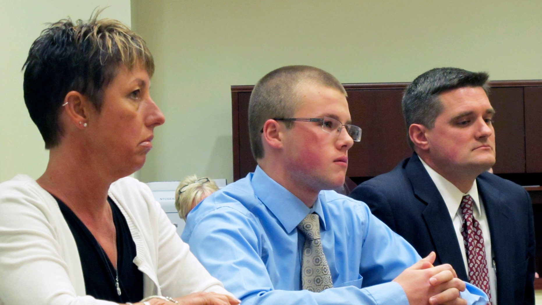 Oct. 22, 2012: Tyler Pagenstecher, 18, center, listens in juvenile court, in Lebanon, Ohio, as a judge sentences him to a minimum of six months in a juvenile jail stemming from his conviction on drug-trafficking charges. Pagenstecher is flanked by his mother, 50-year-old Daffney Pagenstecher, and his attorney, Mike O'Neill.