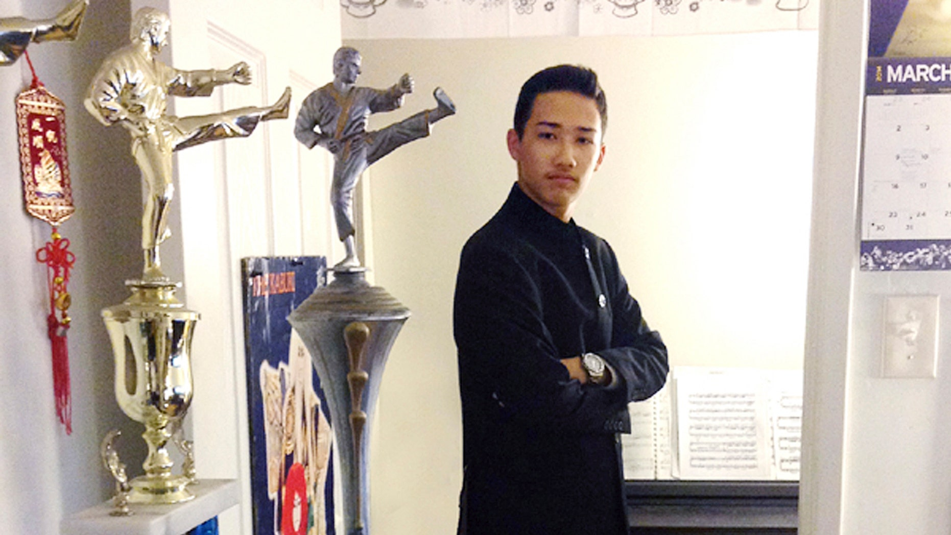 This August 2015 photo provided by Shu Chien shows her son Moshe Kai Cavalin at their home in San Gabriel, Calif. Cavalin earned a bachelorâs in math from UCLA at age 15, and is taking online classes through Brandeis University, near Boston, towards a masterâs in cybersecurity. Heâs also working for NASA, where he is developing aircraft tracking technology. (Shu Chien via AP)