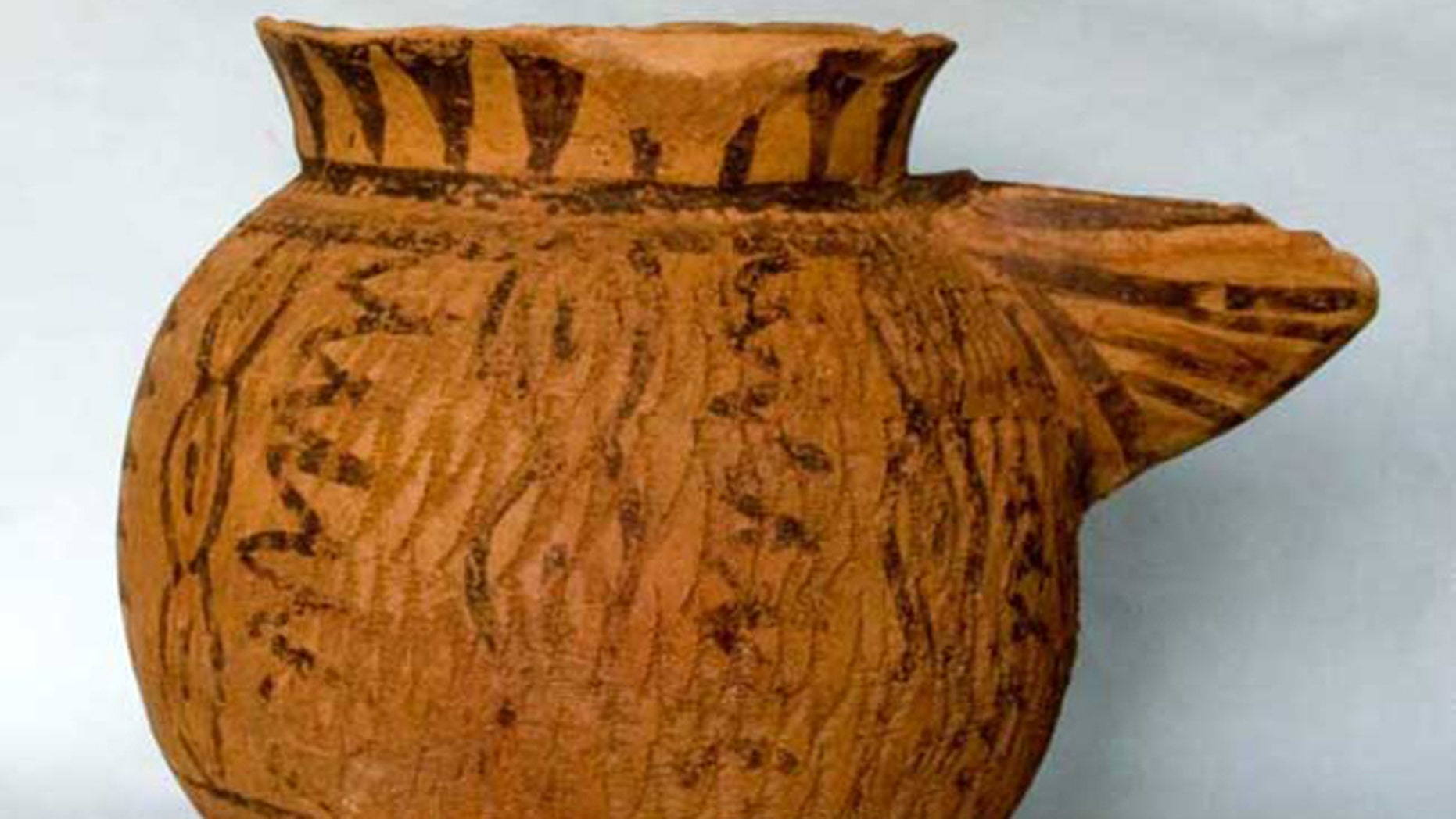 This strainer-spouted pitcher is from the Halaf period and dates from about 5400 B.C. It is painted and impressed in a pattern of connected ovals that is a common motif in the Halaf culture, and was found in the newly discovered prehistoric town of Tell Zeidan, near modern-day Syria.