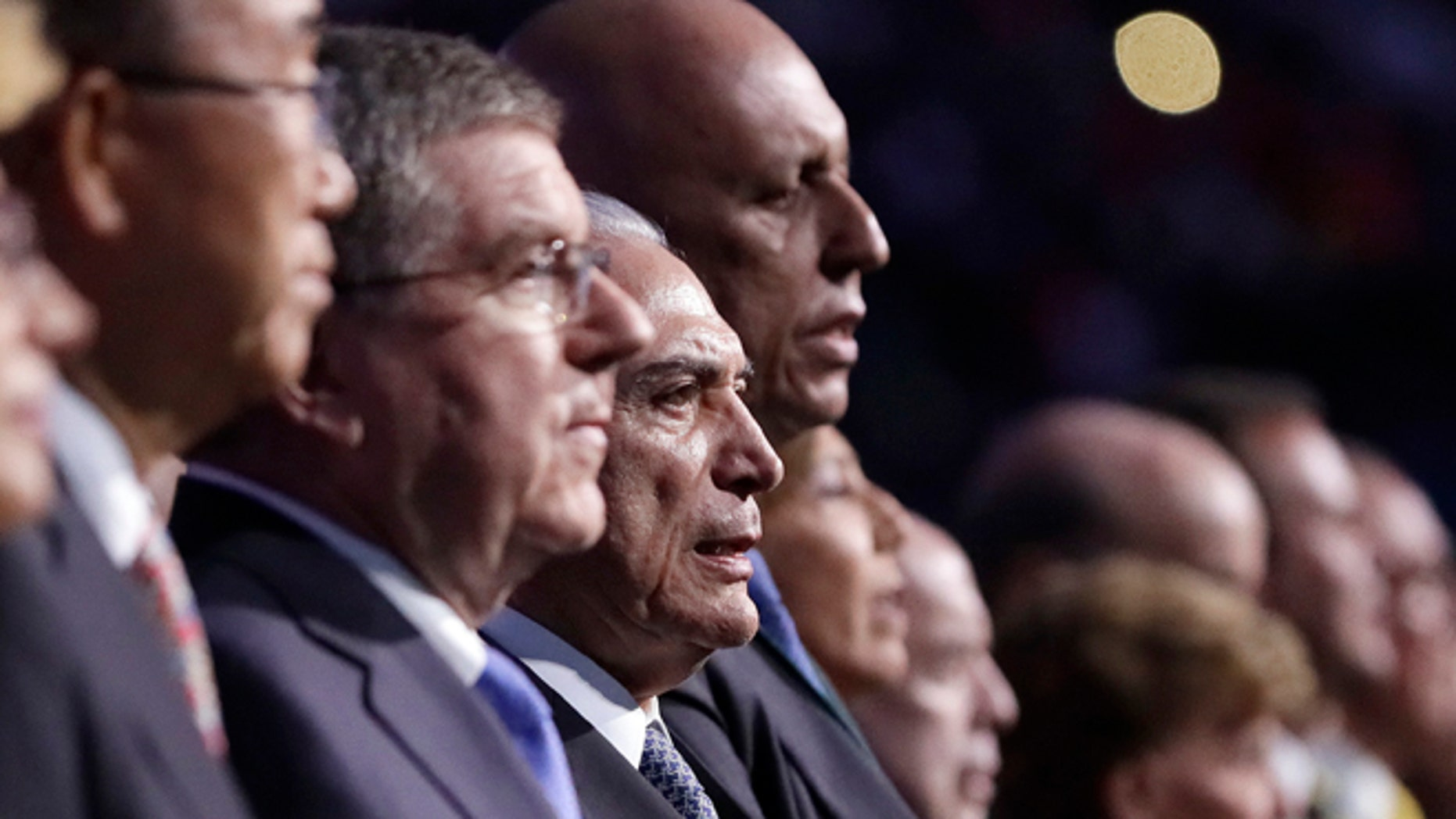 Brazil interim President Michel Temer, third from left, sings the Brazilian national anthem during the opening ceremony for the 2016 Summer Olympics in Rio de Janeiro, Brazil, Friday, Aug. 5, 2016. (AP Photo/Mark Humphrey, Pool)