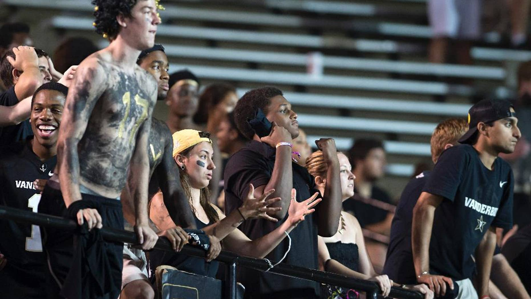 Vanderbilt fans react to a dropped pass in the fourth quarter of an NCAA college football game Friday, Aug. 29, 2014, in Nashville, Tenn. (AP Photo/Brian Powers)