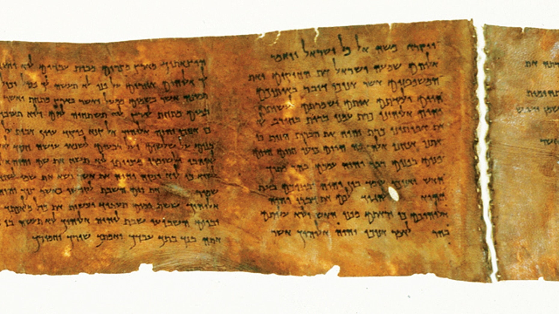 A portion of the oldest complete copy of the Ten Commandments, on display potentially for the final time in New York CIty's Times Square.