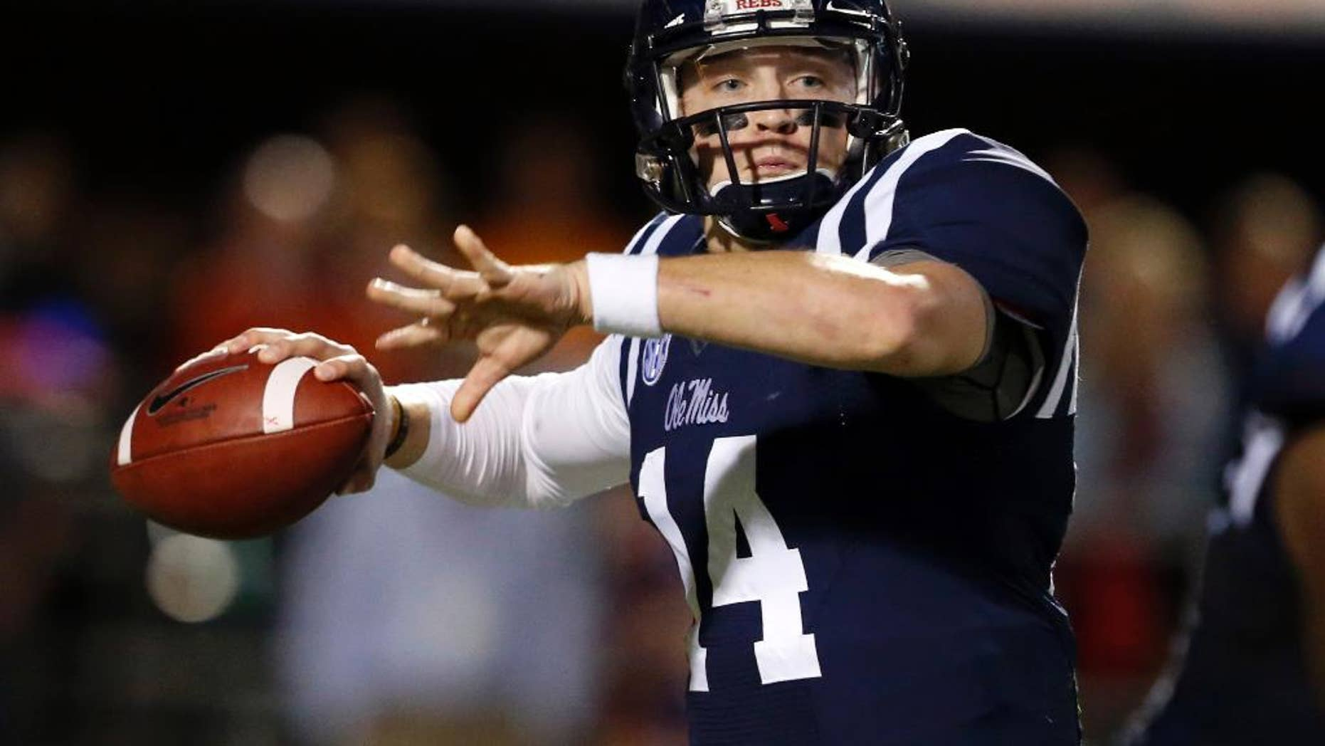 Mississippi quarterback Bo Wallace readies to pass against Tennessee in the second half of an NCAA college football game in Oxford, Miss., Saturday, Oct. 18, 2014. No. 3 Mississippi won 34-3. (AP Photo/Rogelio V. Solis)