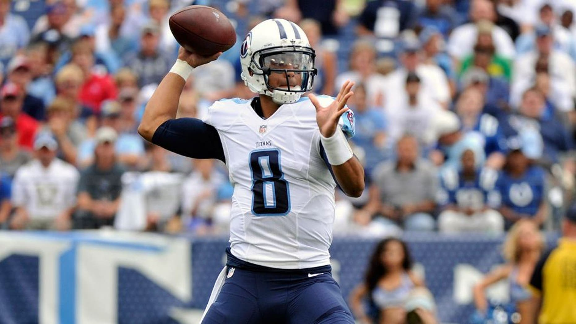 NASHVILLE, TN - SEPTEMBER 27: Marcus Mariota #8 of the Tennessee Titans drops back to throw a pass against the Indianapolis Colts at Nissan Stadium on September 27, 2015 in Nashville, Tennessee. (Photo by Frederick Breedon/Getty Images)