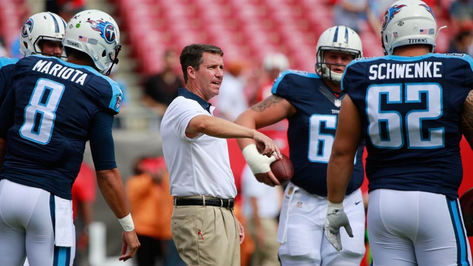 Sep 13, 2015; Tampa, FL, USA; Tennessee Titans quarterback coach John McNulty talks with center Brian Schwenke (62), quarterback Zach Mettenberger (7) and quarterback Marcus Mariota (8) prior to the game at Raymond James Stadium. Mandatory Credit: Kim Klement-USA TODAY Sports