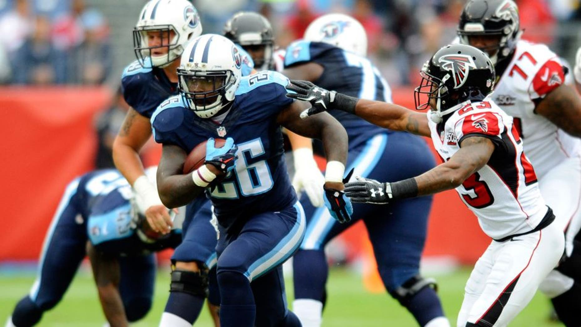 Oct 25, 2015; Nashville, TN, USA; Tennessee Titans running back Antonio Andrews (26) runs for a first down during the first half against the Atlanta Falcons at Nissan Stadium. Mandatory Credit: Christopher Hanewinckel-USA TODAY Sports