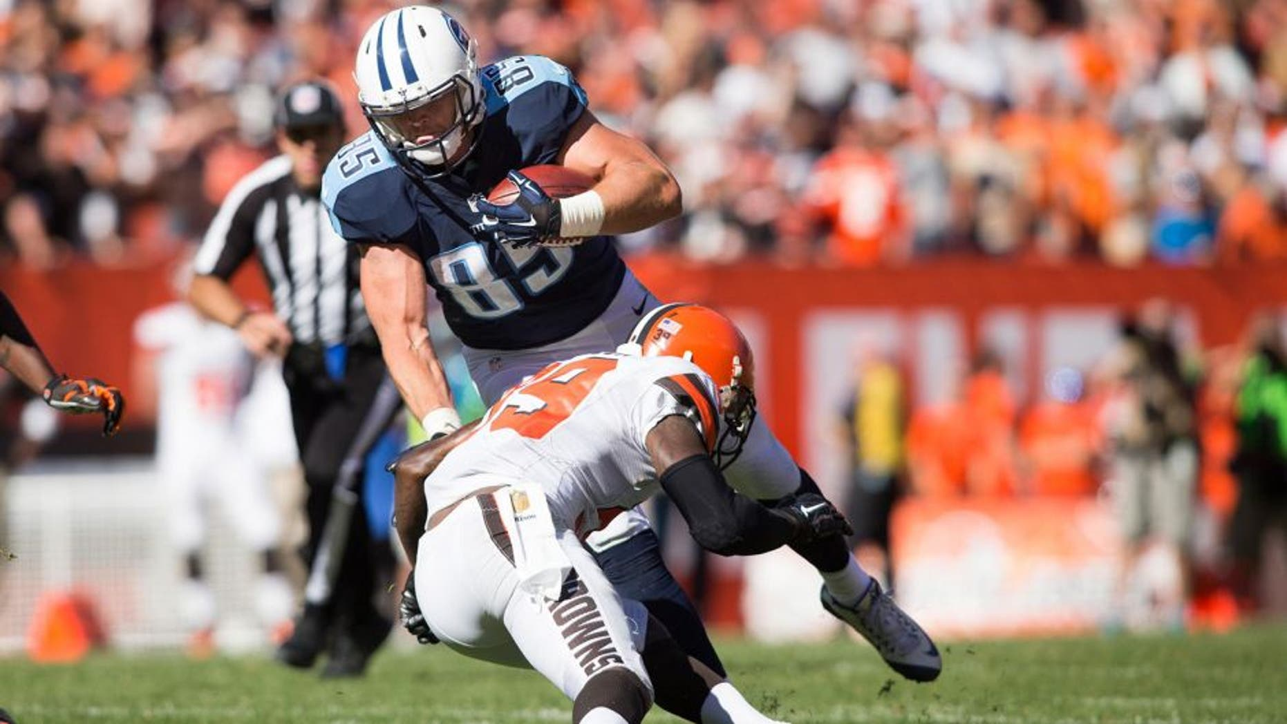 Sep 20, 2015; Cleveland, OH, USA; Tennessee Titans tight end Chase Coffman (85) gets tackled by Cleveland Browns free safety Tashaun Gipson (39) during the fourth quarter at FirstEnergy Stadium. Mandatory Credit: Scott R. Galvin-USA TODAY Sports