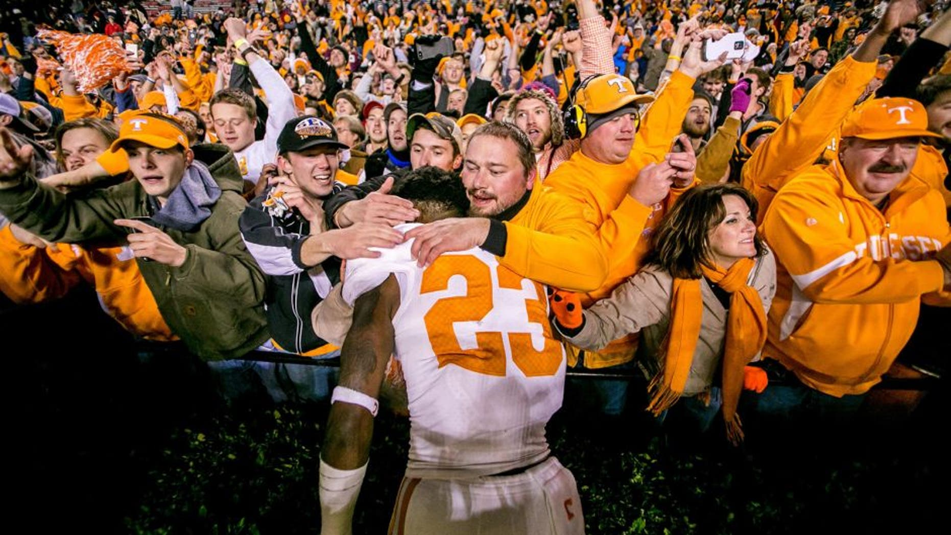 Nov 1, 2014; Columbia, SC, USA; Tennessee Volunteers defensive back Cameron Sutton (23) celebrates with fans following their overtime win over the South Carolina Gamecocks at Williams-Brice Stadium. Mandatory Credit: Jeff Blake-USA TODAY Sports