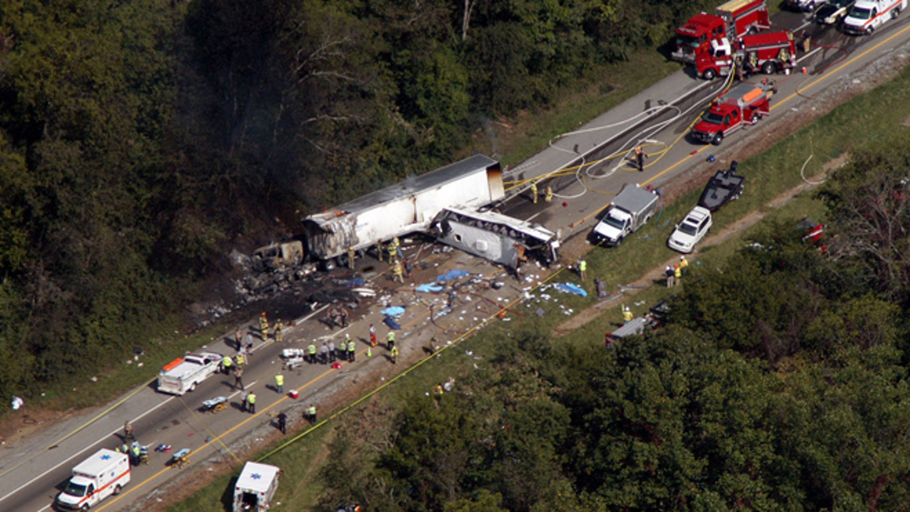 Oct. 2, 2013: In this aerial photo, emergency workers respond to a crash involving a church bus and a tractor-trailer near Dandridge, Tenn.