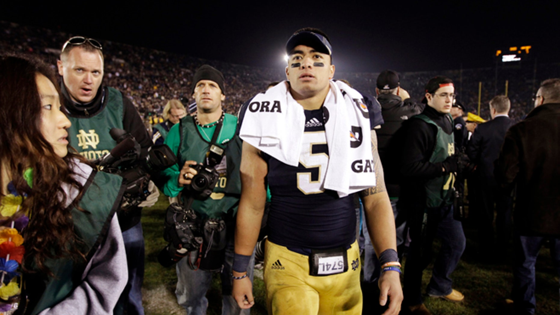 Nov. 17, 2012: In this file photo, Notre Dame linebacker Manti Te'o walks off the field following an NCAA college football game against Wake Forest in South Bend, Ind.