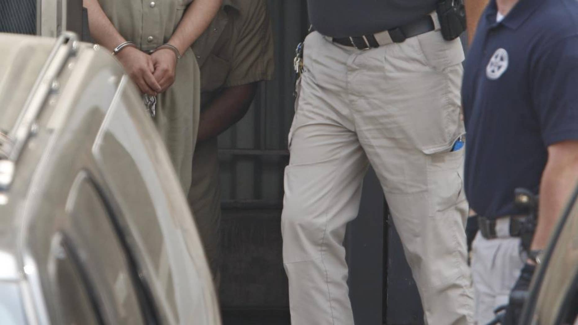 """US Marshall's lead Mufid A. Elfgeeh, 30, a naturalized U.S. citizen from Yemen, out of Federal Court following a hearing Monday, June 1, 2014 in Rochester. The Rochester man was indicted Tuesday Sept. 16, 2014 on charges that he tried to provide material support to the Islamic State by helping three men who said they would travel to Syria to """"engage in violent jihad"""" alongside the group's militants, according to the Justice Department.  (AP Photo/Democrat & Chronicle, Shawn Dowd)"""