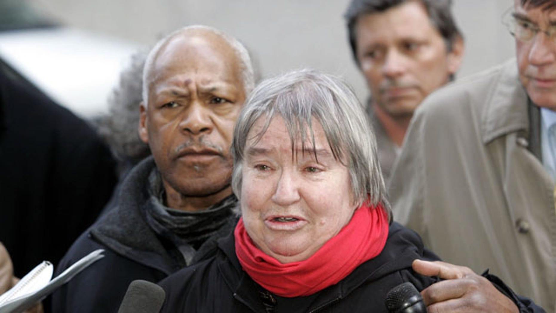 FILE - In this Feb. 10, 2005 file photo, attorney Lynne Stewart cries as she speaks to the press with her husband Ralph Pointer next to her, left, outside Federal Court in New York. Stewart, a former civil rights lawyer convicted in a terrorism case and sentenced to 10 years in prison is entitled to compassionate release because she has less than 18 months to live. (AP Photo)