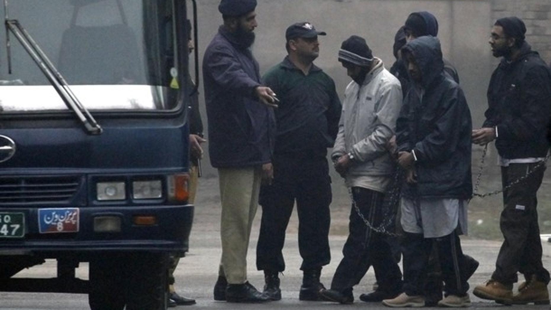 Jan. 18: Pakistani police escort five Americans held on terror charges in Punjab province, Pakistan.