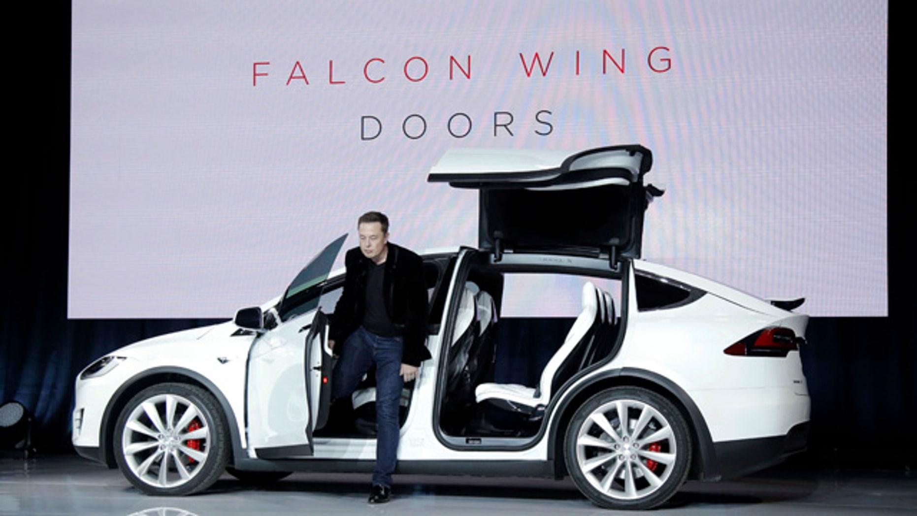 Sept. 29, 2015: Elon Musk, CEO of Tesla Motors Inc., introduces the Model X car at the company's headquarters in Fremont, Calif. (AP Photo/Marcio Jose Sanchez)