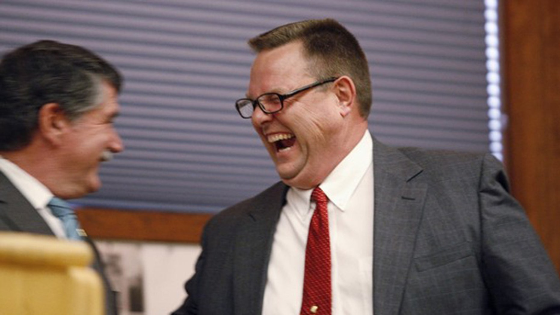 FILE: June 10, 2012: Sen. Jon Tester, D-Mont., laughs with Rep. Denny Rehberg, R-Mont., before the first debate of the 2012 election in Big Sky, Mont.