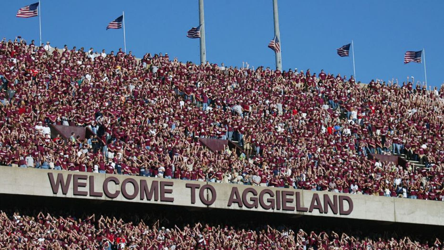 COLLEGE STATION, TX - NOVEMBER 6: Texas A&M University Aggies fans, sometimes referred to as the 12th Man, watch the game against the University of Oklahoma Sooners on November 6, 2004 at Kyle Field in College Station, Texas. The Sooners defeated the Aggies 42-35. (Photo by Ronald Martinez/Getty Images)