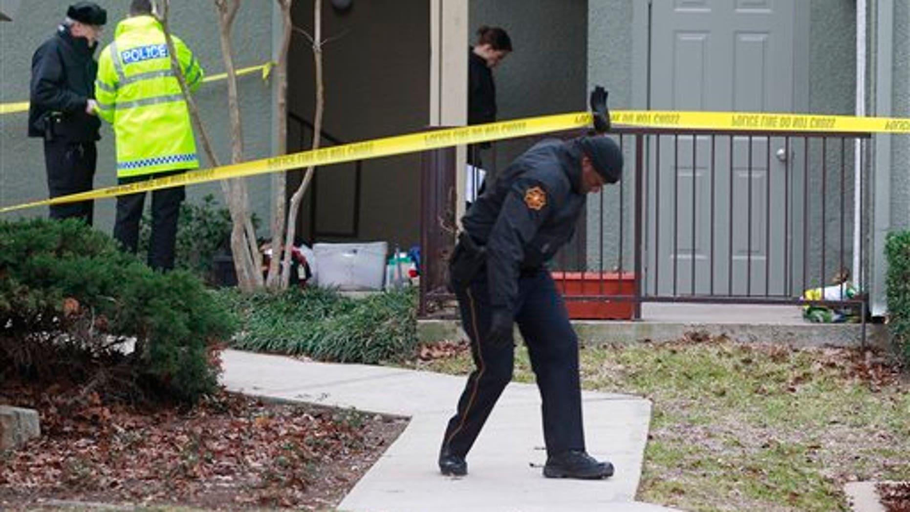 Dec. 25: Grapevine police investigate the scene where they found seven people dead outside Dallas in Grapevine, Texas.