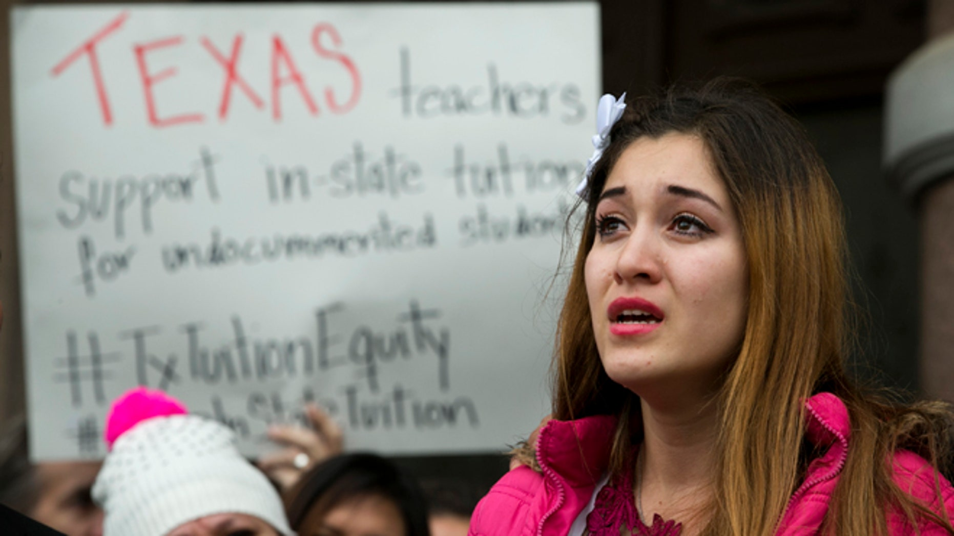 Nahiely Garcia, 19, of Edinburg, cries as she speaks in support of the HB1403, the Texas DREAM Act, at a demonstration at the Capitol in Austin, Texas, on Wednesday January 14, 2015.  More 50 people, a coalition of businesses, affected students, supporters, and lawmakers, rallied to preserve the 2001 in-state tuition law.  (AP Photo/Austin American-Statesman, Jay Janner)