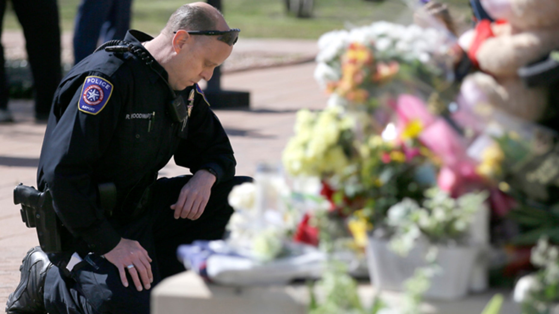 A makeshift memorial for a slain officer at the Euless Police Department  Wednesday, March 2, 2016.
