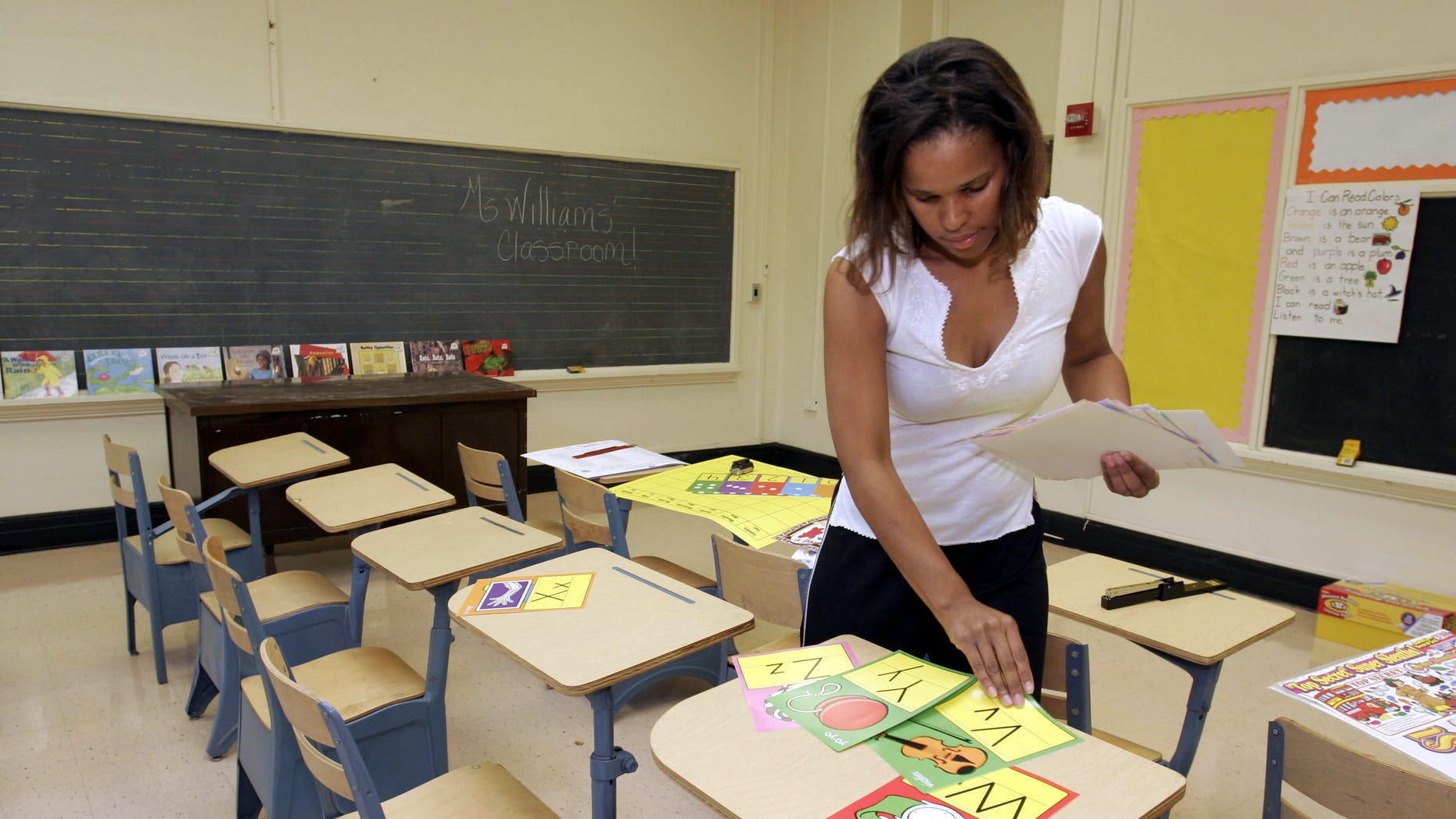Ckaris Williams, a teacher and Hurricane Katrina evacuee, prepares her classroom at Douglass Elementary School in Houston September 7, 2005 in Houston,(Photo by Dave Einsel/Getty Images)