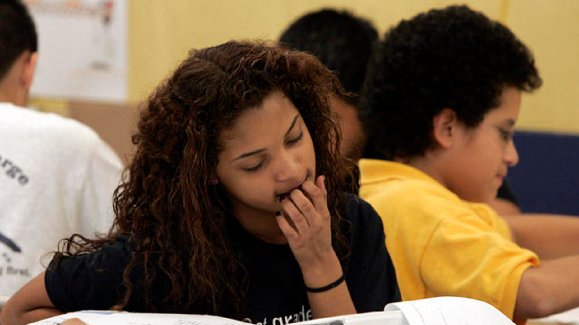 Brianna Burks, 12, works in class at KIPP charter school Tuesday, April 3, 2007, in Houston. While one in six charter schools in Texas fails, Houston-based KIPP continues to expand in poor and minority communities. (AP Photo/Pat Sullivan)