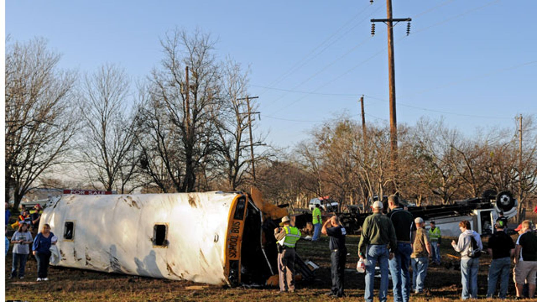 January 17, 2012: Emergency personnel investigate the scene of a wreck where a tractor-trailer clipped a school bus full of students, flipping the bus onto its side and sending 32 people — 29 of them children — to a central Texas hospital in Temple, Texas.