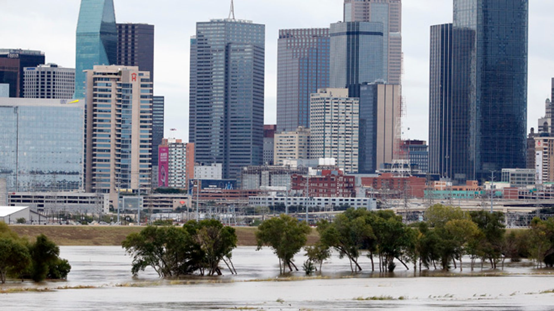 The rain-swollen Trinity River is seen with the city skyline in the background Saturday, Oct. 24, 2015, in Dallas. Southeast Texas was bracing for heavy rain late Saturday and into Sunday as the remnants of Hurricane Patricia combined with a powerful storm system that's been moving across Texas, flooding roads and causing a freight train to derail. (AP Photo/Tony Gutierrez)