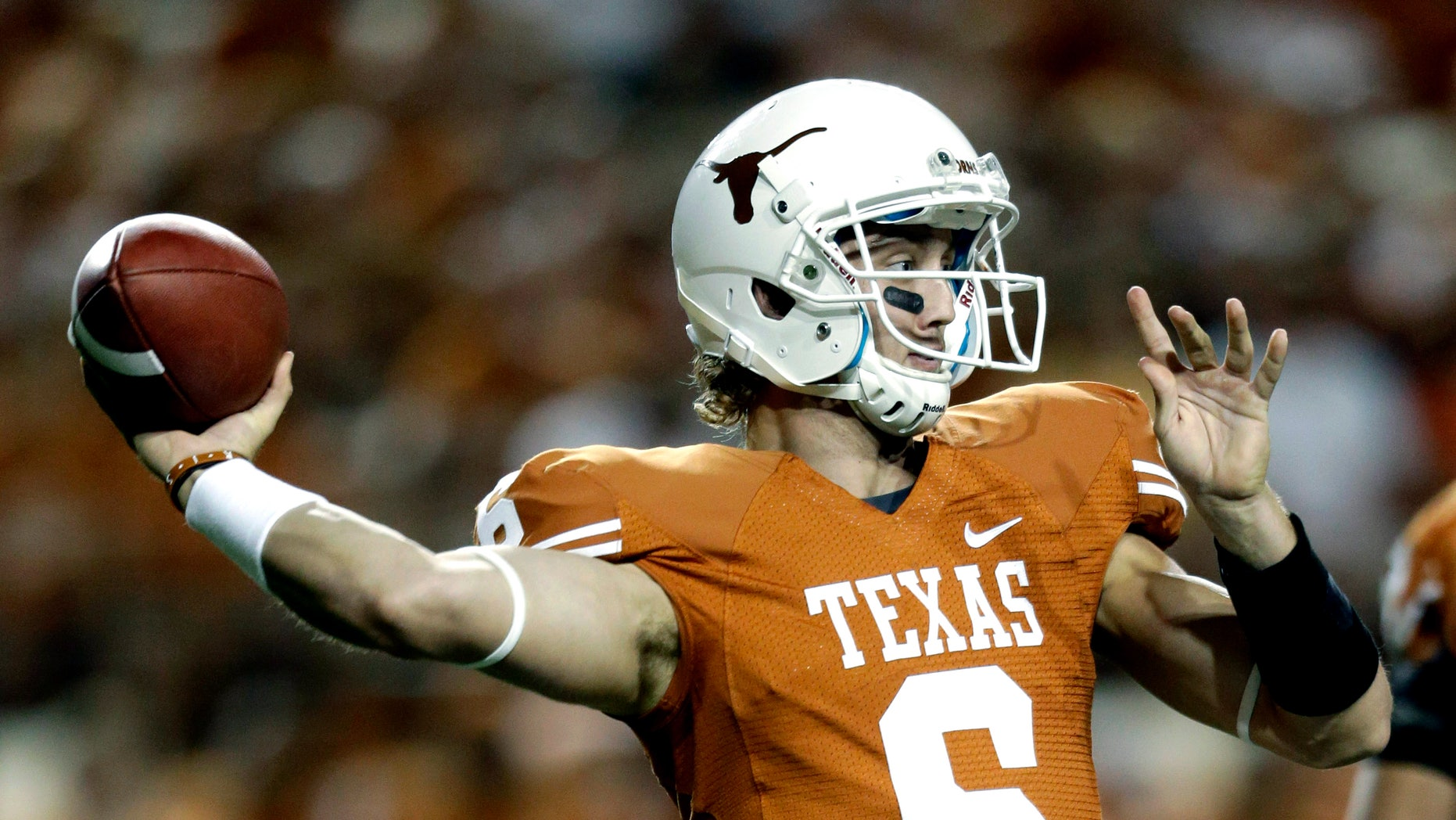 Sept. 8, 2012: In this file photo, Texas' Case McCoy looks to pass against New Mexico during the first quarter of an NCAA college football game in Austin, Texas.