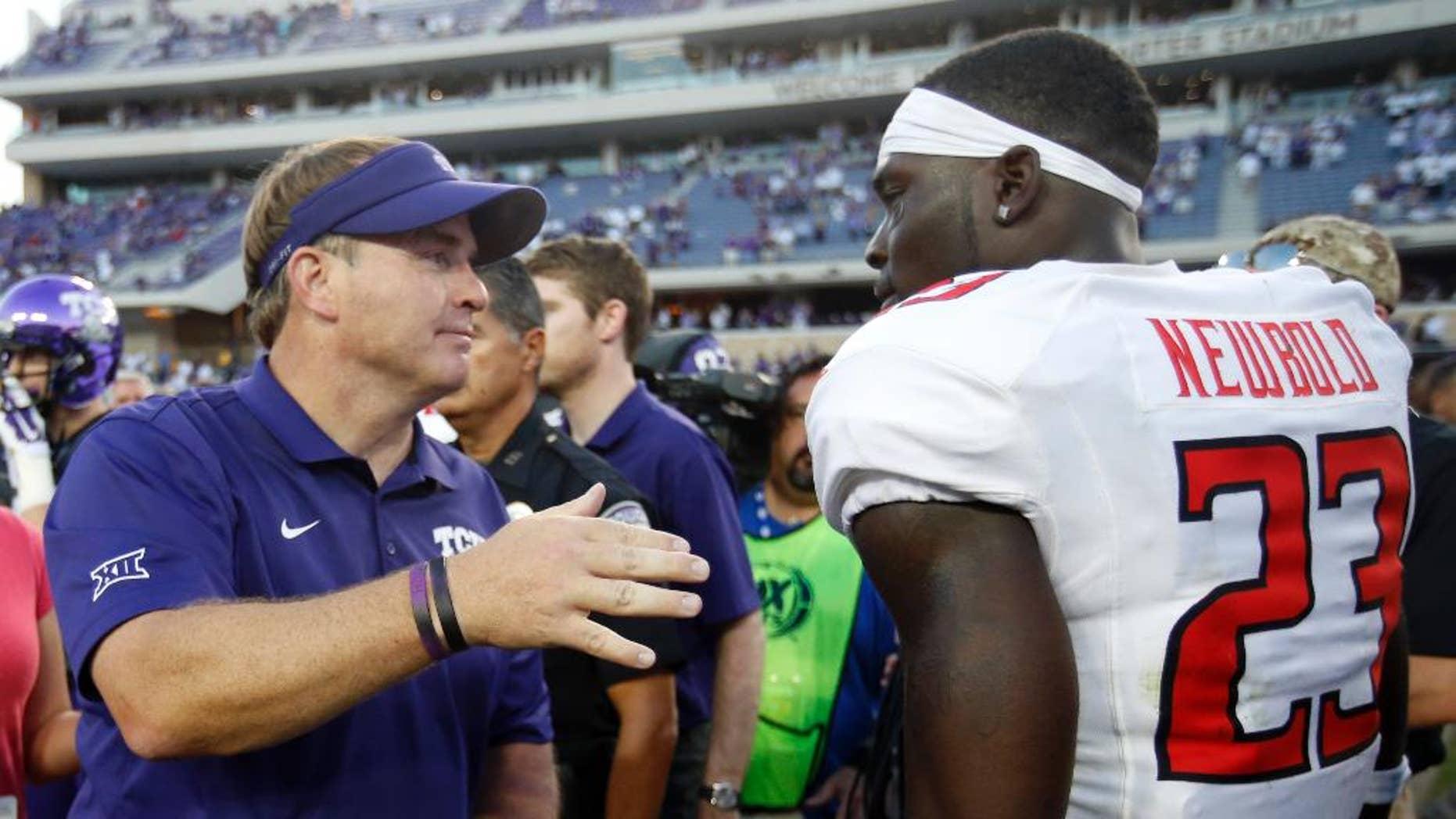 TCU head coach Gary Patterson  talks with Texas Tech defensive back La'Darius Newbold (23) following their NCAA college football game, Saturday, Oct. 25, 2014, in Fort Worth, Texas. TCU won 82-27. (AP Photo/Tony Gutierrez)