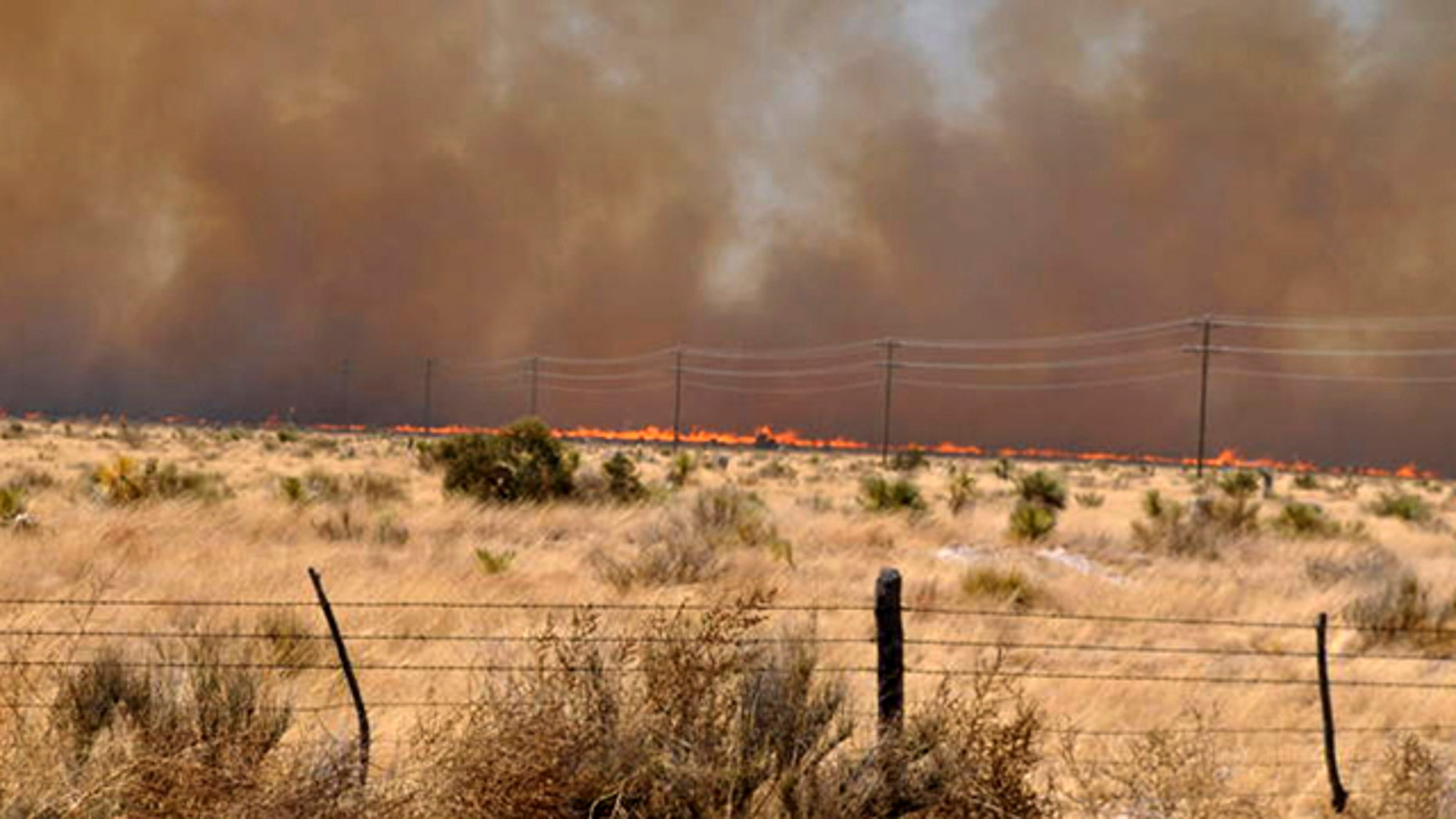 April 10, 2011: An uncontrolled wildfire burns at the Jeff Davis and Presidio County line near Fort Davis, Texas. A fast-moving wildfire had spread to more than 60,000 acres in Presidio County and Jeff Davis County, where it destroyed about 20 homes in Fort Davis.