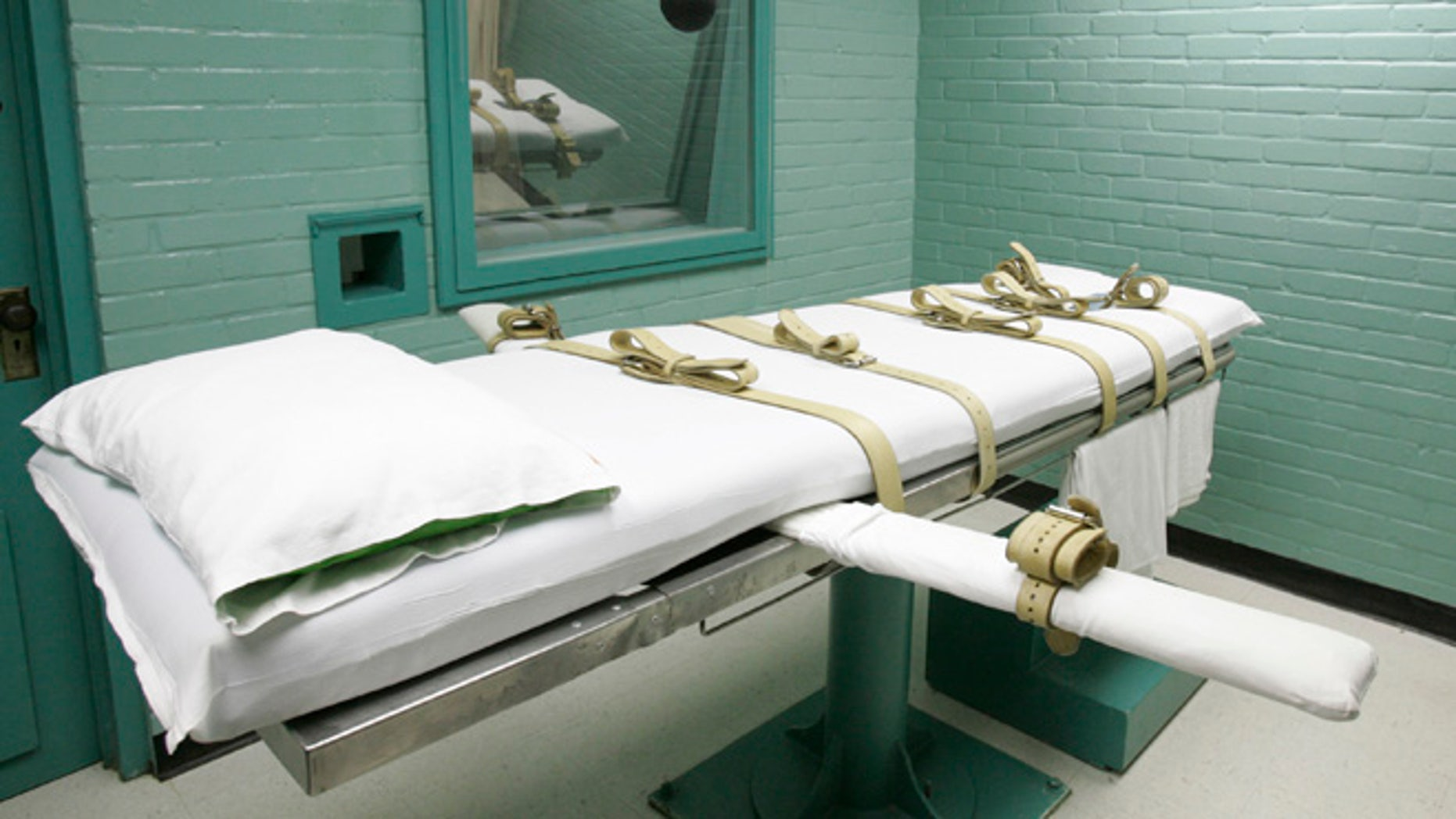 FILE: 2008: A gurney on which Texas' condemned are strapped down to receive a lethal dose of drugs. in Huntsville, Texas.