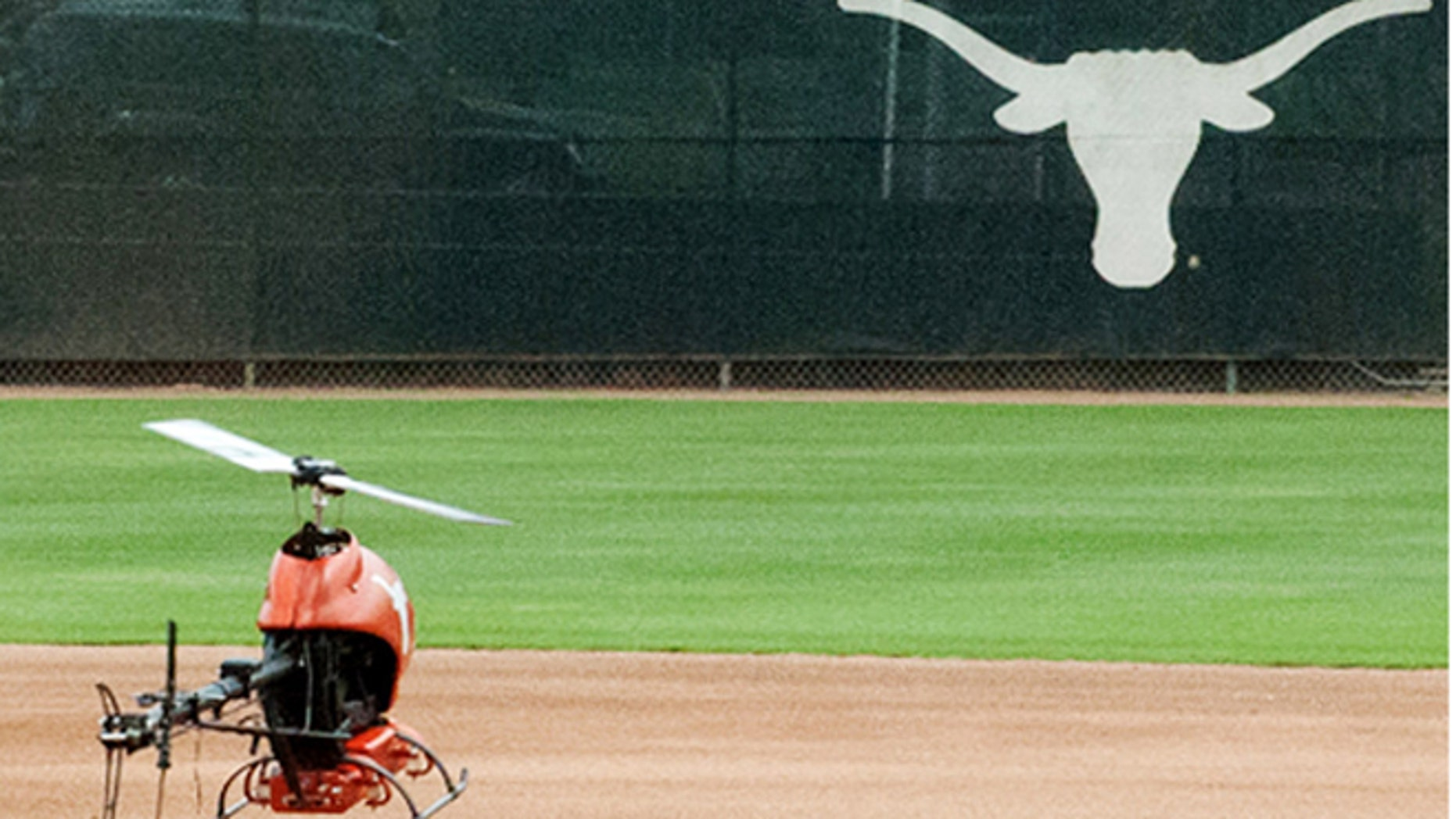 FILE: June 14, 2013: An unmanned drone flies in Darrell K. Royal Memorial Stadium during an experiment by Univ. of Texas Radionavagation Laboratory in Austin, Texas.