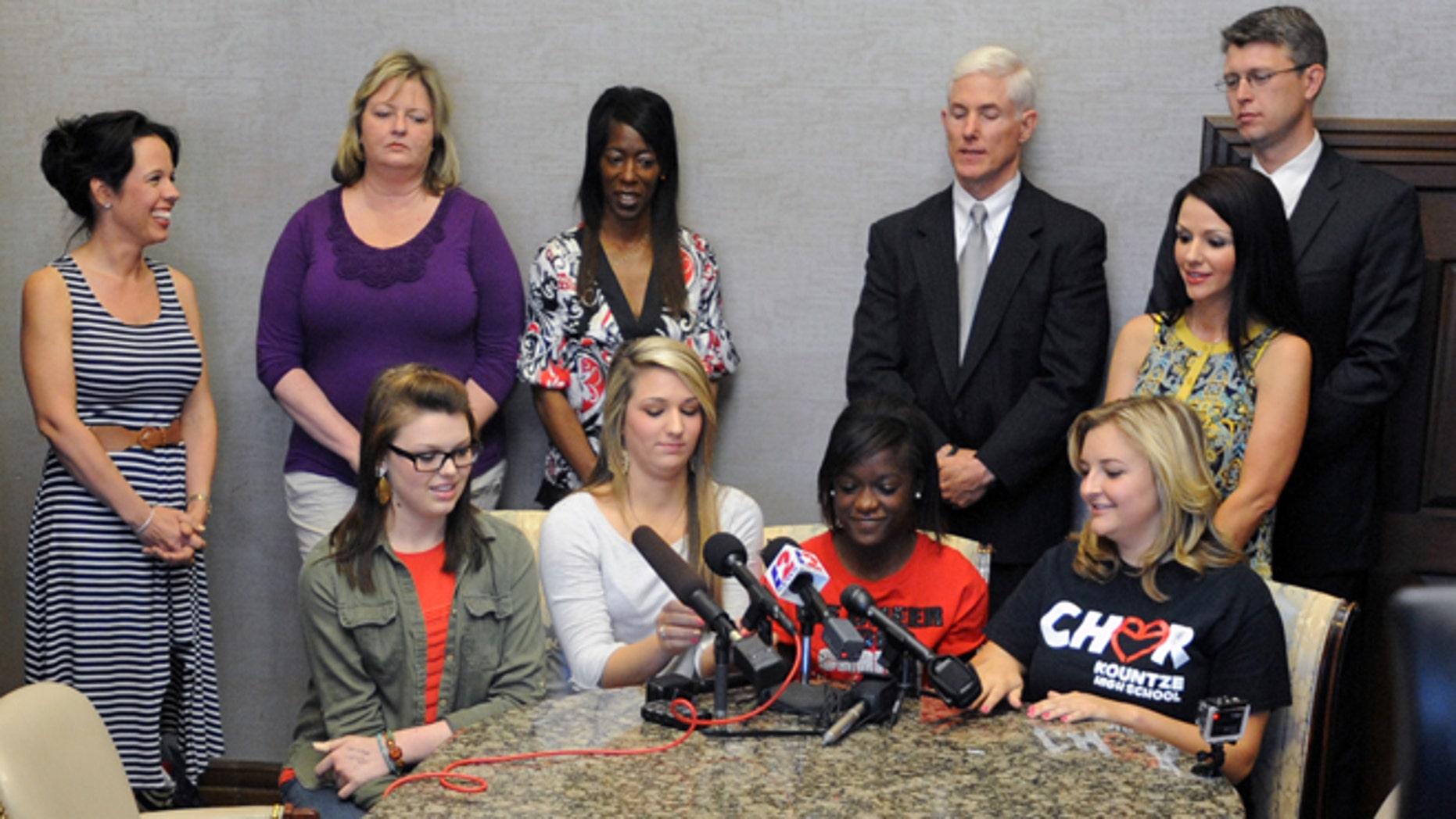 May 8, 2013: Kountze High School cheerleaders, from left, Savannah Short, Macy Matthews, Kieara Moffett and Rebekah Richardson speak to reporters in Beaumont, Texas.