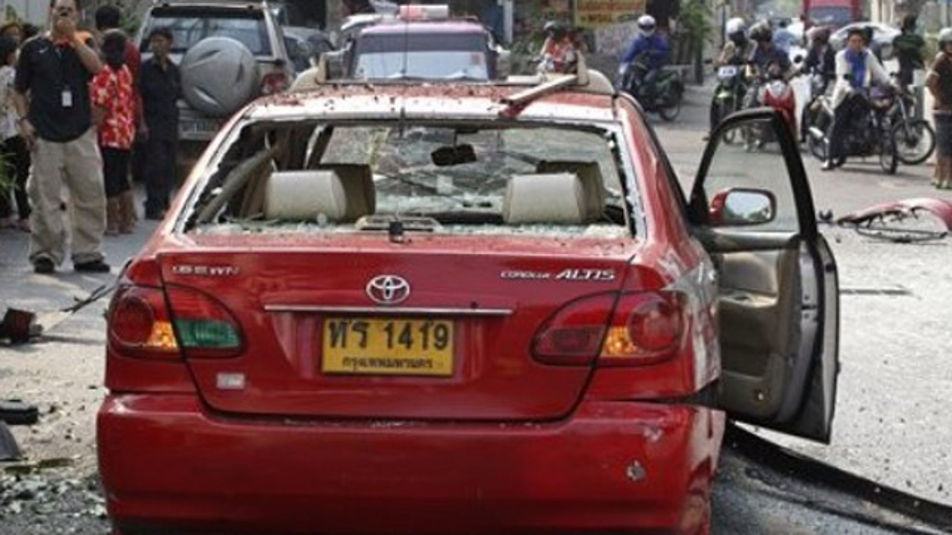 Feb. 14, 2012: Wreckage of a taxi lies on the road at the explosion of an explosion in Bangkok, Thailand.