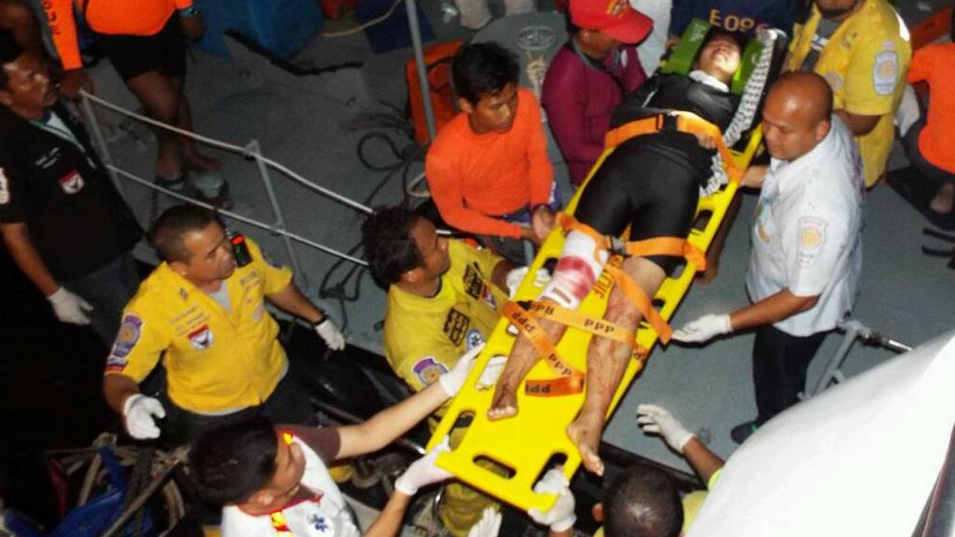 Thai rescue workers  move  a injured tourist on stretcher to hospital  after a fishing boat crashed with a speed boat, carrying tourists from Koh Phi Phi island to a pier in Phuket. Thailand Sunday  Oct. 19, 2014. 27 tourists injured and two are  missing.(AP Photo) THAILAND OUT