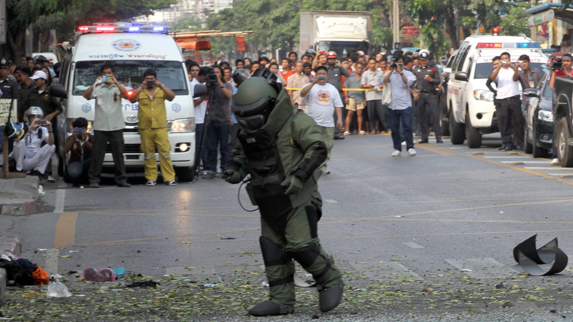 Feb. 14, 2012: A Thai Explosive Ordnance Disposal (EOD) official examines the bomb site in Bangkok, Thailand.