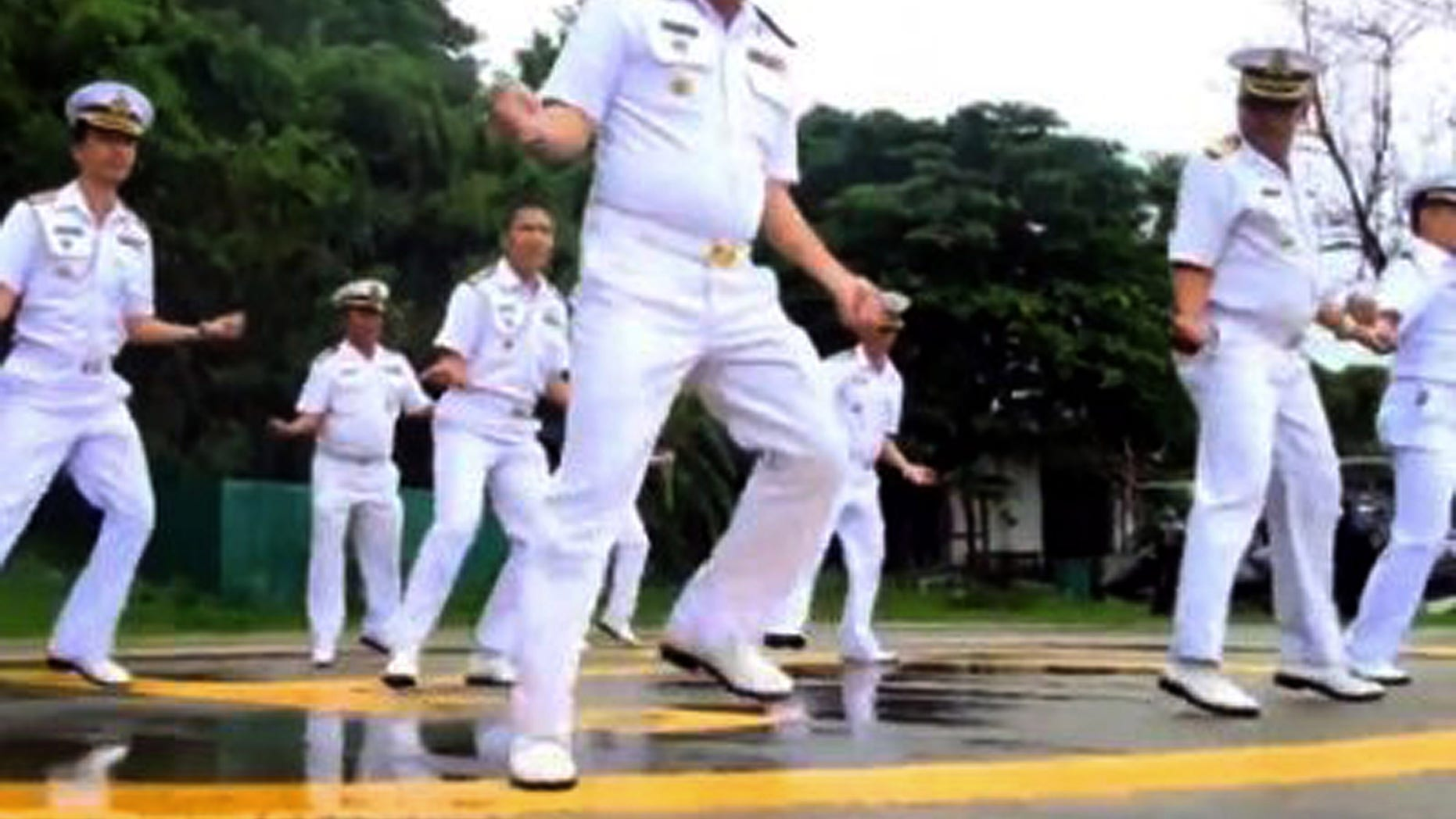 """In this image made from an undated video released by Thai Royal Navy, Thai sailors perform the rodeo-style dance and other hip-shaking moves at their base on the popular tourist island of Phuket, southern Thailand. The """"Gangnam Style"""" craze has reached Thailand's navy, which is among the latest to mimic the globally popular dance video by South Korean singer PSY."""