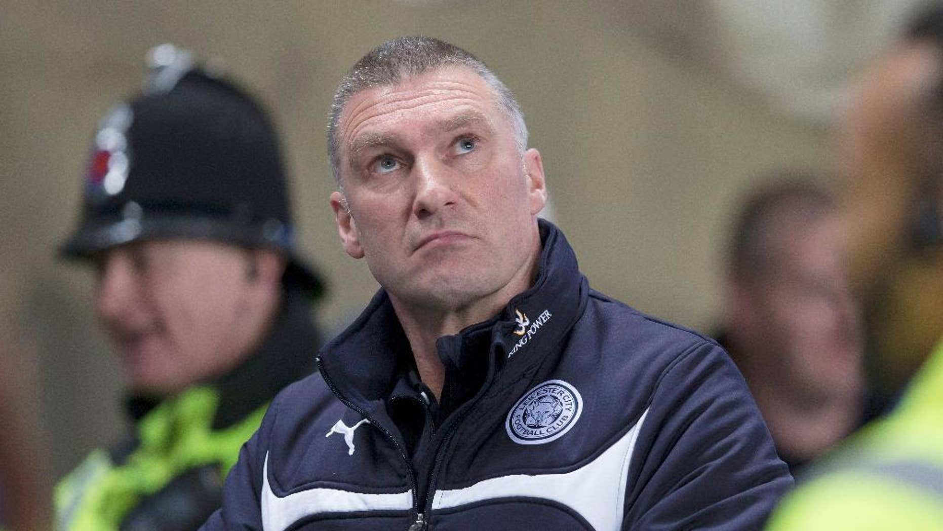 """In this March 4, 2015, file photo, Leicester City manager Nigel Pearson stands at his team's English Premier League soccer match with Manchester City at the Etihad Stadium in Manchester, England. Pearson is also the father of player James Pearson who was with two other players engaging in an apparent orgy with Thai sex workers in a hotel room. It remains unclear how the """"racist orgy"""" video was leaked. But it's safe to say the scandal surrounding Leicester City was not the game plan when its Thai owners and sponsors invited the club to tour Thailand. (AP Photo/Jon Super, File)"""