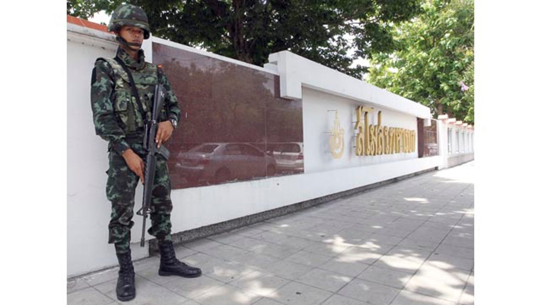 May 29, 2014: A Thai soldier stands guard at the Army Club in Bangkok. (AP Photo/Apichart Weerawong)
