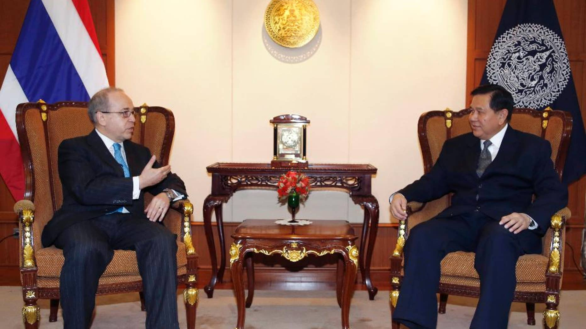 FILE - In this Monday, Jan. 26, 2015, file photo, U.S. Assistant Secretary of State for East Asian and Pacific Affairs Daniel Russel, left, talks to Thai Deputy Prime Minister and Foreign Minister Tanasak Patimapragorn during their meeting at the Foreign Ministry in Bangkok, Thailand. Russel's controversial speech to students at Chulalongkorn University on Monday has laid bare the delicate path Thailand's leaders have been trying to navigate since toppling a democratically elected government in May, both by keeping a lid on dissent at home and by maintaining good relations with foreign allies abroad. (AP Photo/Sakchai Lalit, File)