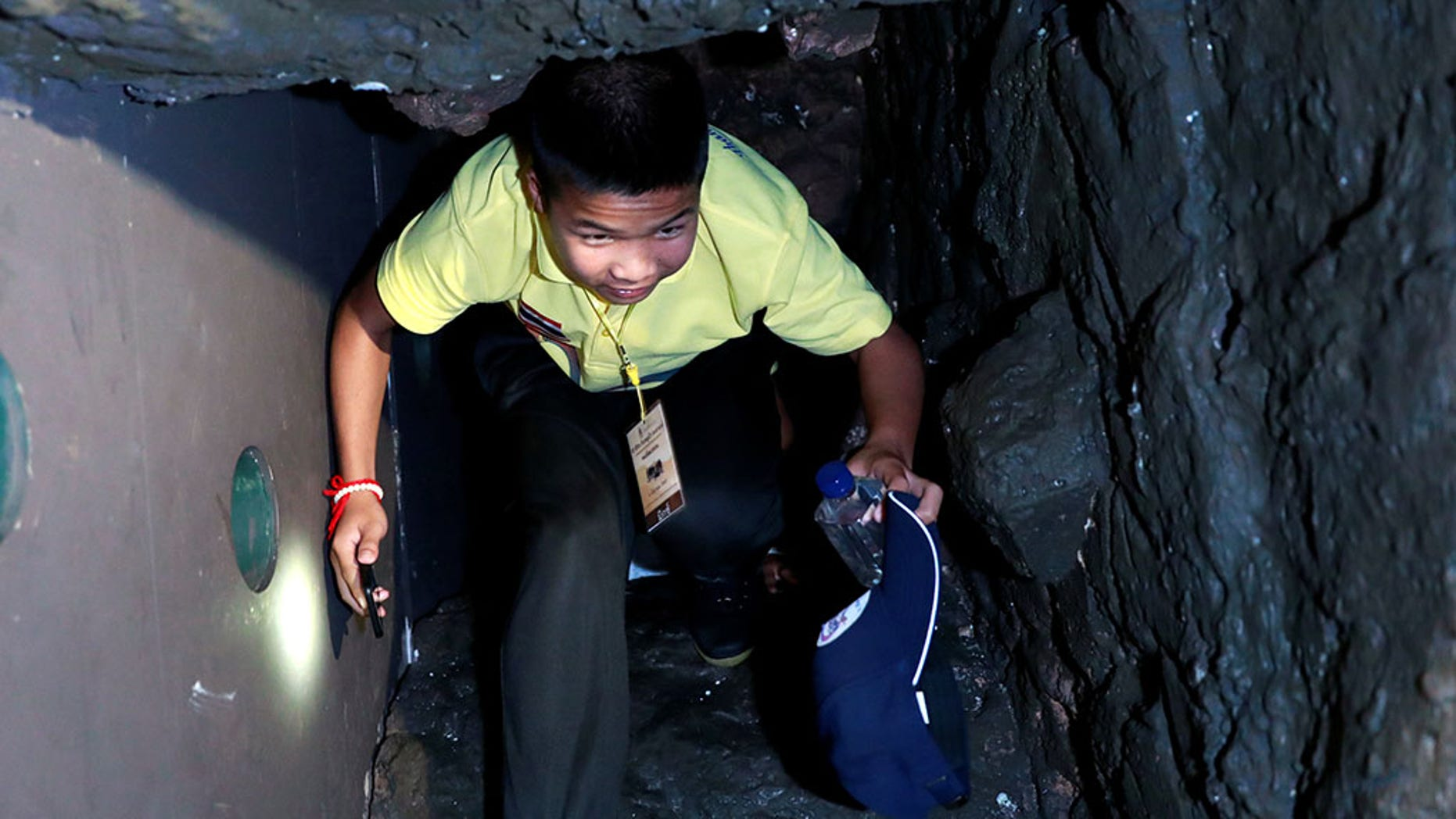 A member of the soccer team maneuvering through the fake cave tunnel on Thursday.