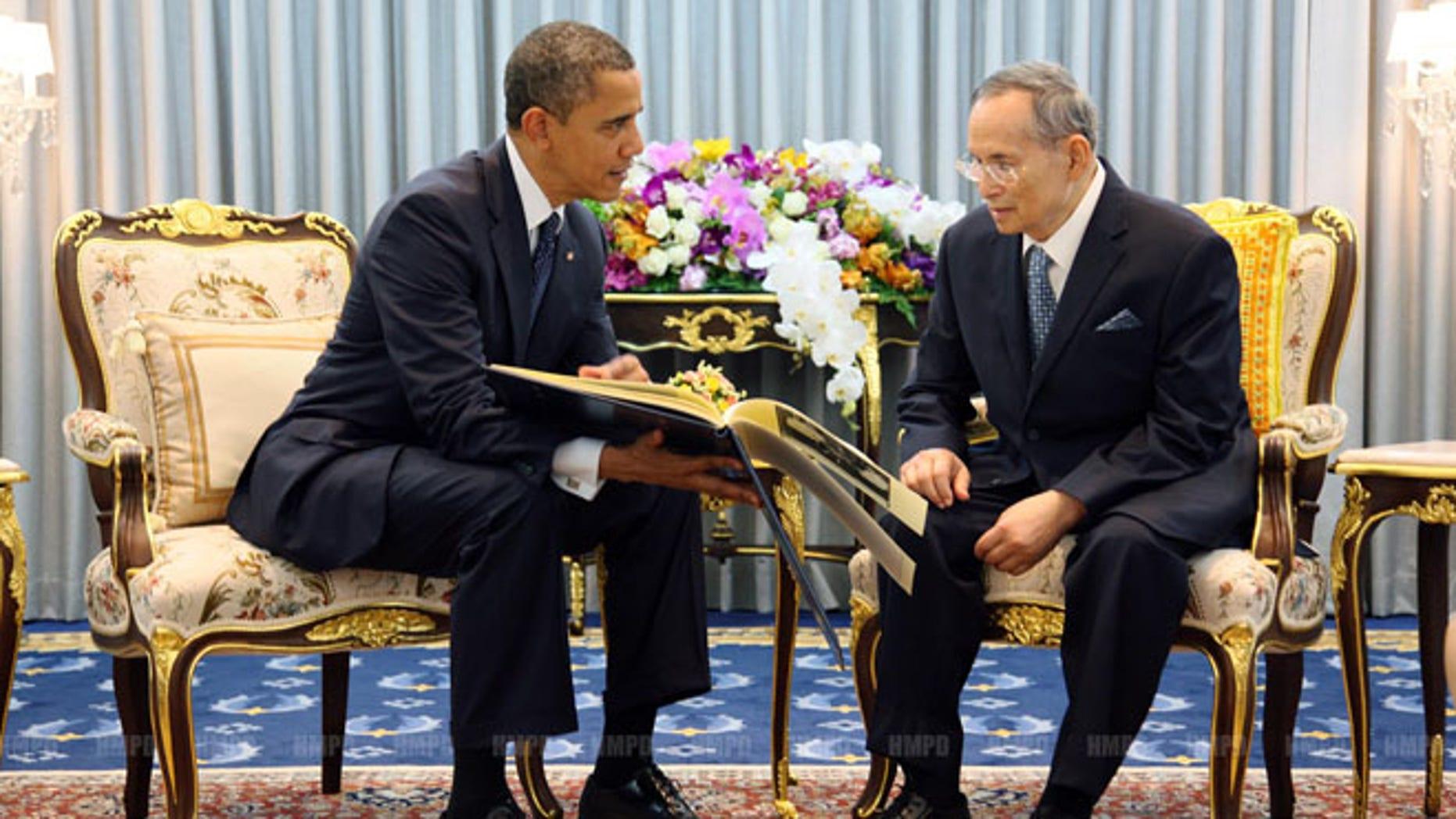 Sunday, Nov. 18, 2012: President Obama, left, talks with Thailand King Bhumibol Adulyadej, at Siriraj Hospital in Bangkok, Thailand.