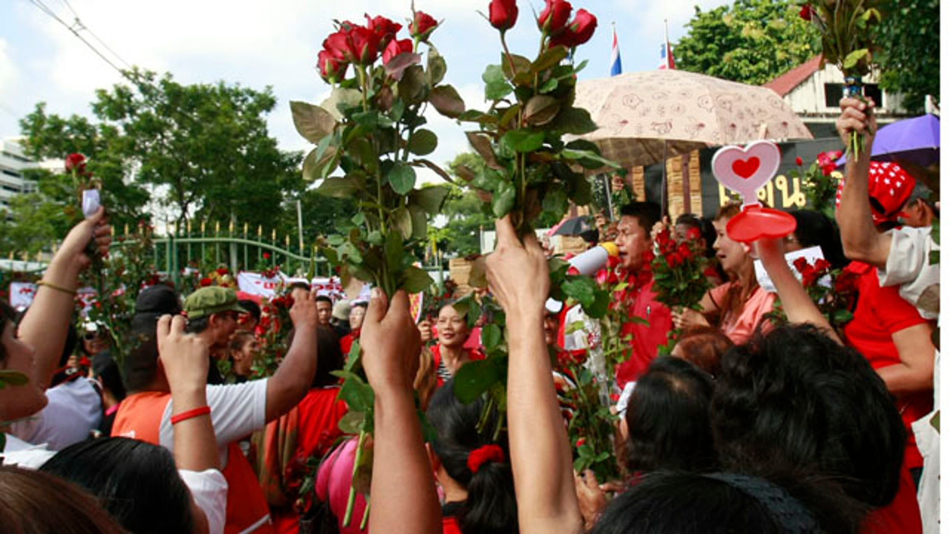 Sept. 17, 2010: Members of the United front for Democracy against Dictatorship (UDD), or Red Shirt, cheer to speech of a colleague during a rally outside a prison in Bangkok, Thailand.